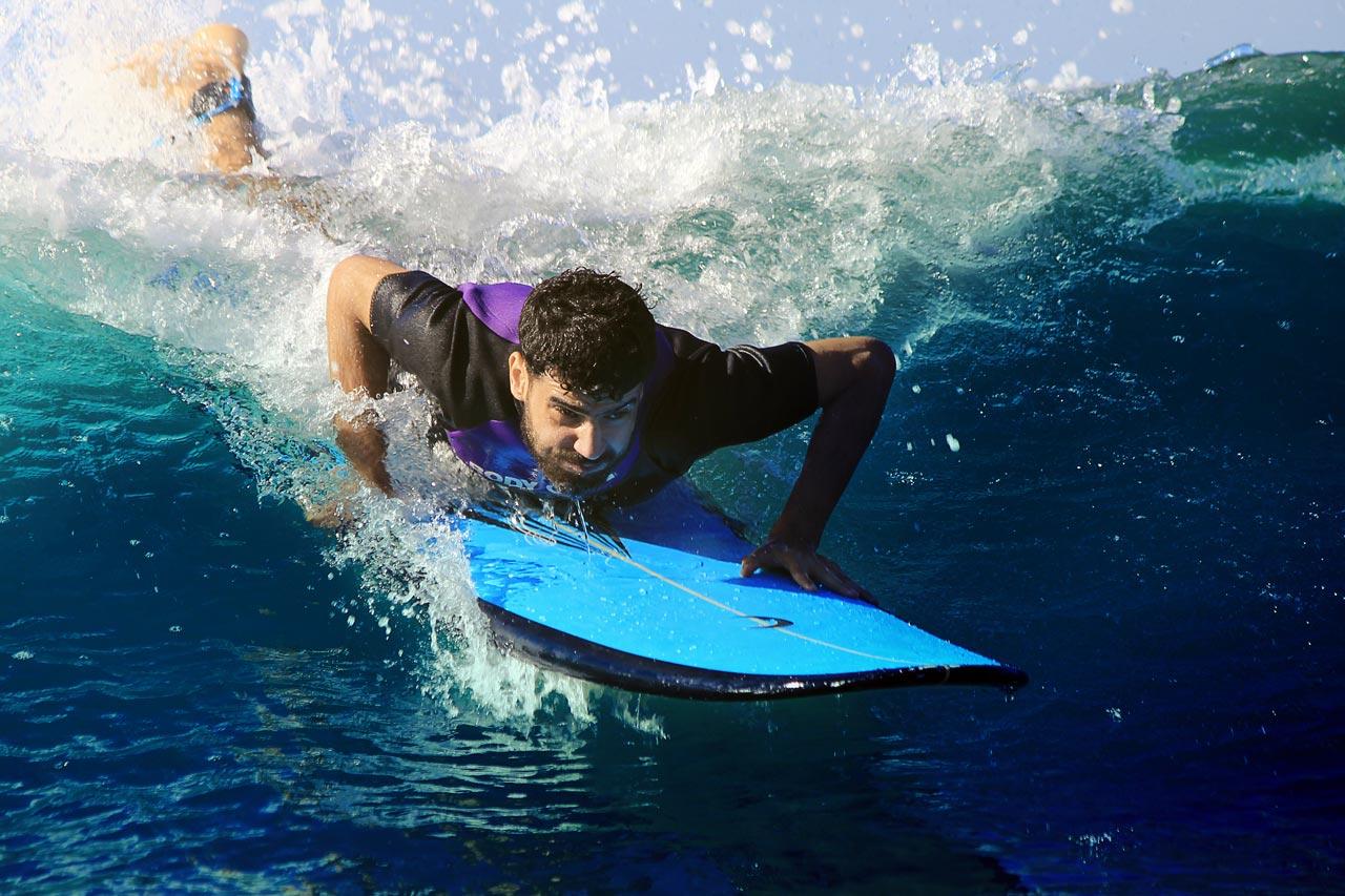 Surfer beim Take-Off